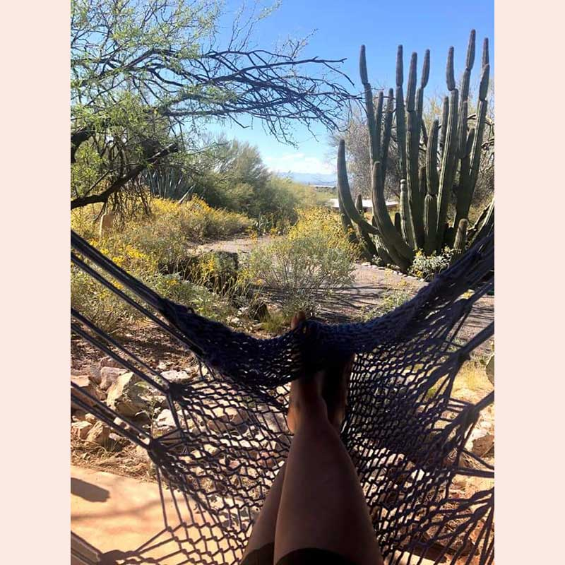 A relaxing day in a woven swinging chair with Chrysalis Hammocks