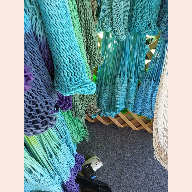 Wide assortment of woven chairs with Chrysalis Hammocks