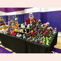 Jack from Hooks and Chains with all of his crocheted creatures