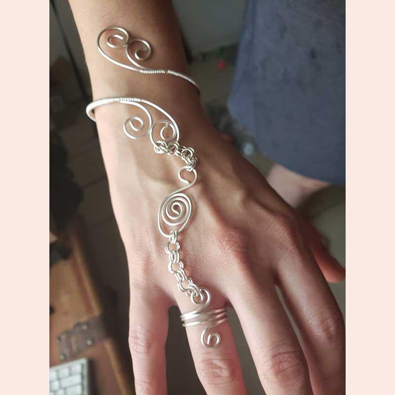 Delicate metal bracelet by Manipulations In Wire